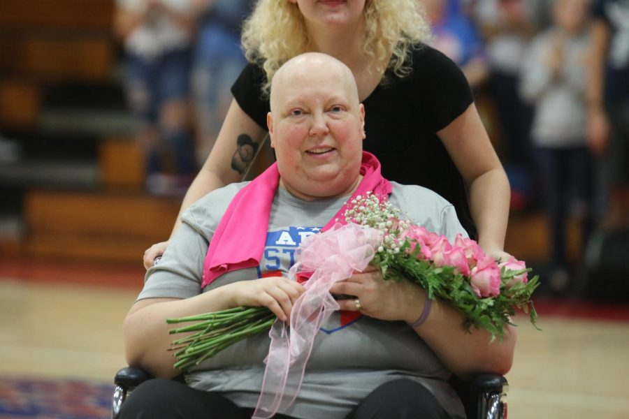 Mrs. Presley at the Homecoming pep-session being honored with a PRIDE award.