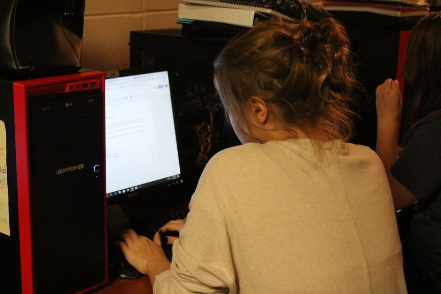 Student author Leah Fraser works on writing a story.