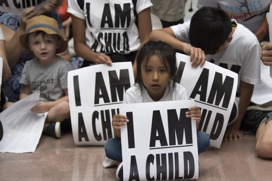 Children participate in a protest against child separation of illegal immigrants detained at the border in the Senate Hart Office Building.