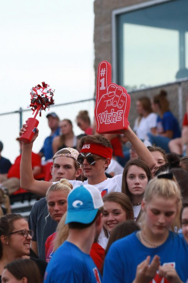 A Student from the Student Section supports his team. Photo By: Lauren Ka