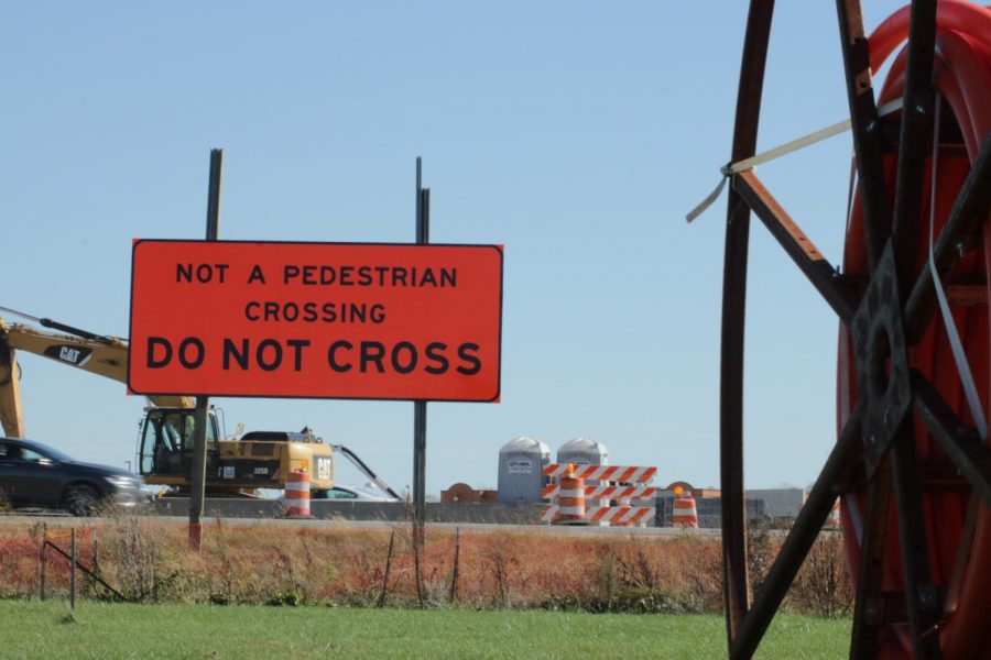This ´Do Not Cross' sign is located outside of the band parking lot at the high school.
