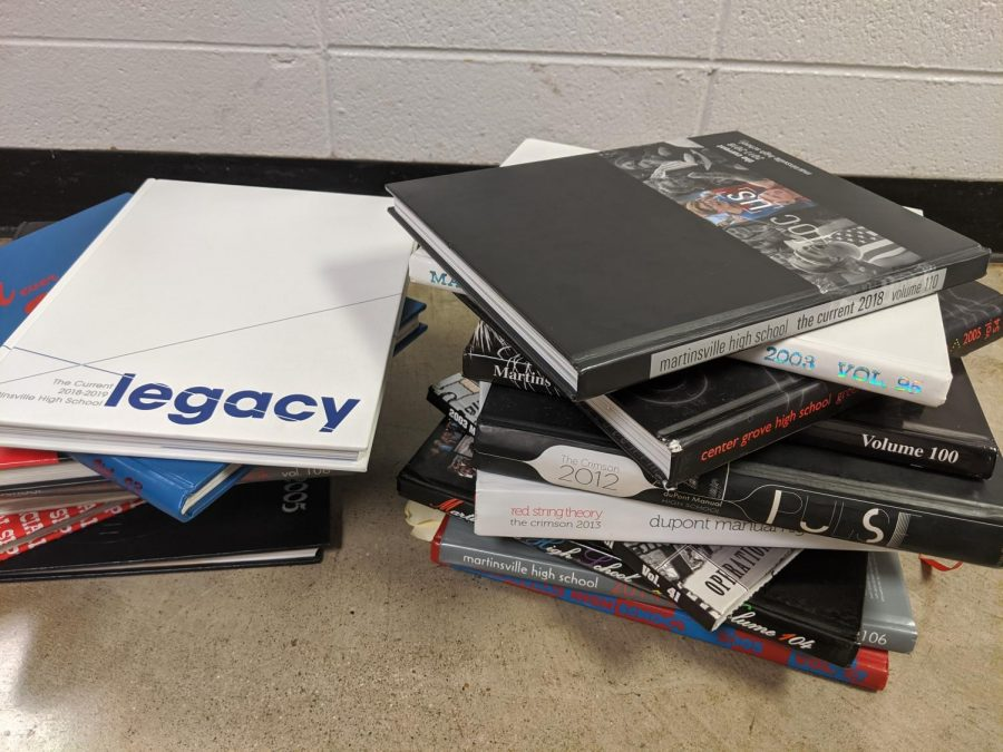 Pictured above is a stack of yearbooks from over the years.