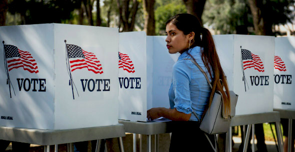 A girl votes at her polling place in her hometown.