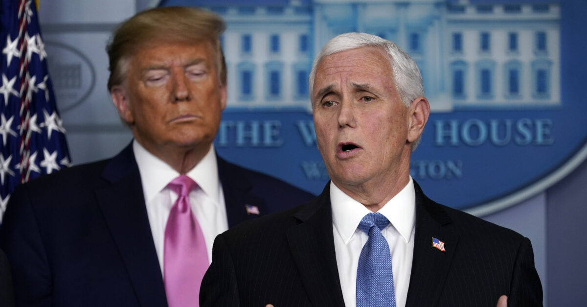 Vice President Mike Pence speaks as President Donald Trump listens during a news conference about the coronavirus in the Brady Press Briefing Room of the White House, Wednesday, Feb. 26, 2020, in Washington.