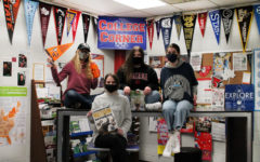 Some MHS students wearing college gear in the Senior Success Center