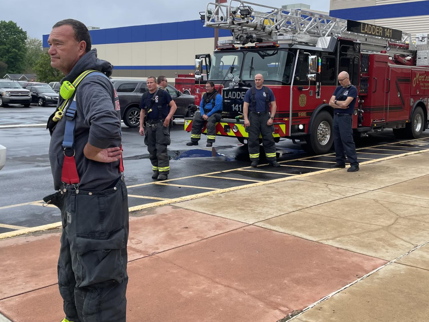 Fire fighters standing outside of MHS after investigating the source of the smoke.
