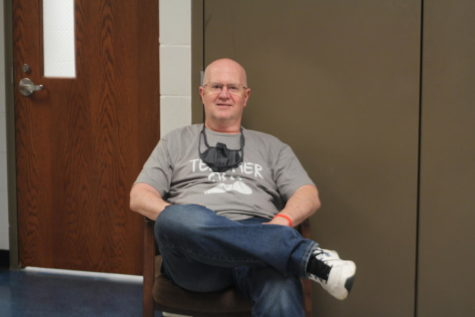 Mr. Lund lounges in the hallway on the last day of school.